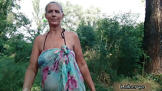 Lukerya takes off her bra in get under one's forest