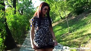 Hot brunette shows some goods during a walk
