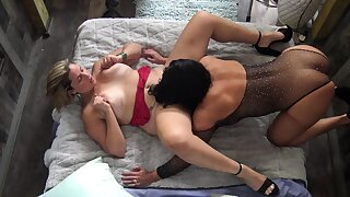 Busty MILFs licking increased by toying each others stained pussies